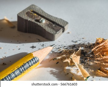 Sharpener in action on black and yellow color pencil