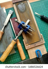 Sharpening chisels using sandpaper and honing guide. Chisel is one of the wood working equipment