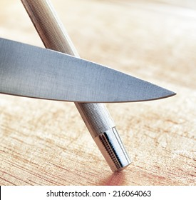 Sharpening of knife in a kitchen.