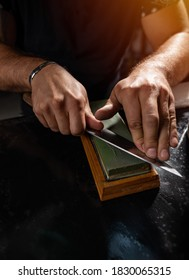Sharpening the knife with whetstone, close up shot