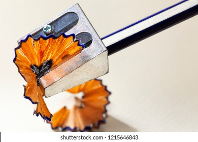 Sharpening a pencil with a metal sharpener