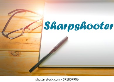 Sharpshooter  - Abstract hand writing word to represent the meaning of word as concept. The word Sharpshooter is a part of Action Vocabulary Words in stock photo.