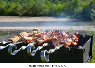 Shashlik, meat is grilled on skewers  on the mangal in nature.