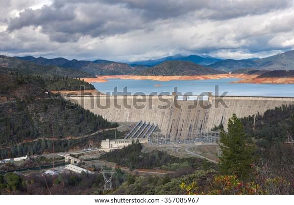 Shasta Dam is a concrete arch-gravity dam across the Sacramento River in Northern California