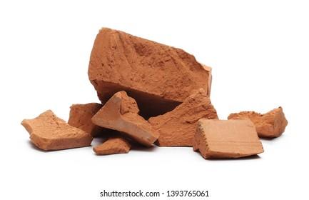 Shattered, broken bricks isolated on white background