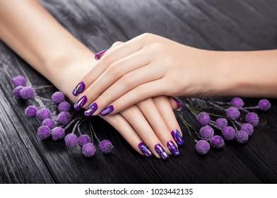 Shattered glass purple manicure on black background