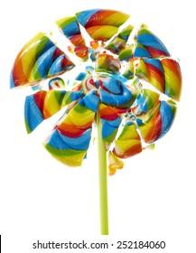 Shattered lollipop on white background