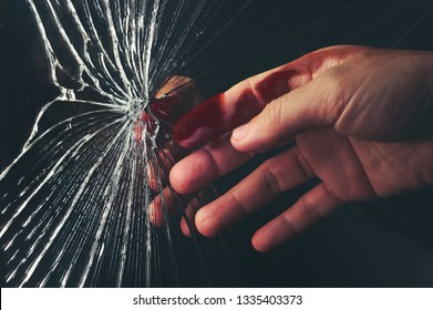 Shattered mirror or crack glass with finger got some blood.