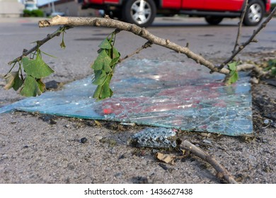 Shattered window on road in tornado aftermath
