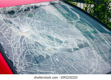Shattered windscreen of an expensive car
