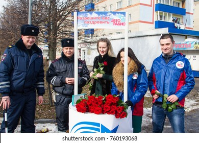 SHATURA, MOSCOW REGION, RUSSIA - MARCH 8, 2017: Police officers congratulate female drivers on international women's day