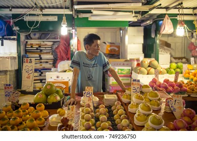 Shau Kei Wan, Hong Kong - October 21, 2017: People on the street market in Shau Kei Wan district in Hong Kong on October 21, 2017.