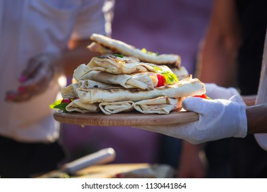 Shaurma, shaurma doner, meat with vegetables in a bread cake, on a light stone or concrete background. Concept restaurant fast food. Catering.