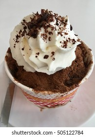 shave ice with chocolate powder and cream on white dish