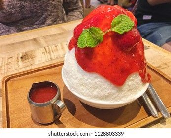 Shaved ice of frozen milk has cheesecake ,cracker pie inside ,topped on with fresh strawberry fruits ,strawberry flavor sauce is a delicious sweet creamy dessert. Japanese call this menu is Kakigori.