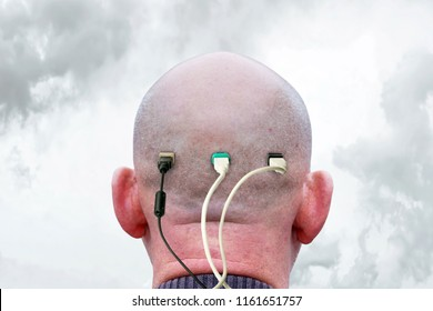 Shaved male nape and a lot of usb cables connected to it. Concept of dependence in thinking and information