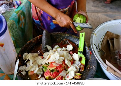 shaved rujak. Indonesian fruit salad with hot spicy sauce. the process of making from kneading spices, until served