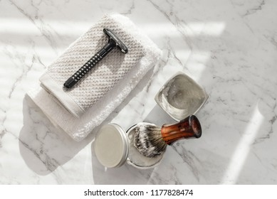 Shaving accesoriess on a clean, white background