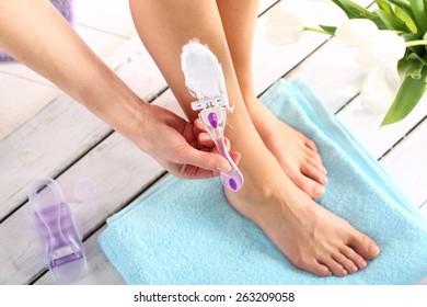 Shaving legs.Female legs goals manual razor