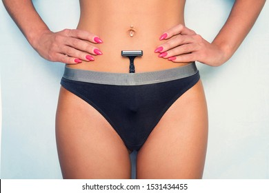 shaving machine in panties. girl health and intimate hygiene. Beautiful Woman's body with smooth soft skin in black bikini panties. Epilation Concepts. blue background
