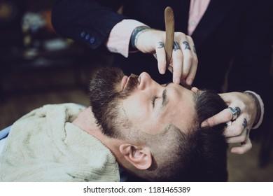 Shaving man and razor man. Hairstylist in barbershop interior. Senior man visiting hairstylist in barbershop. Barber - Shaves and Trims. Hair style and hair stylist. Razor blade