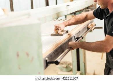 shaving with plane in a professional  woodworker workshop