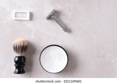 Shaving Still Life: Top view of a safety razor and accessories.