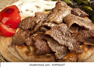 Shawarma Beef Turkish traditional doner on wooden Plate concept
