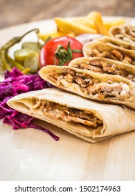 Shawarma with chicken on wood table