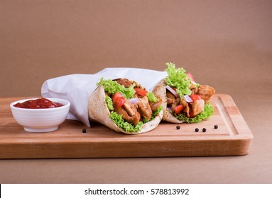 Shawarma chicken sandwich with tomato ketchup.