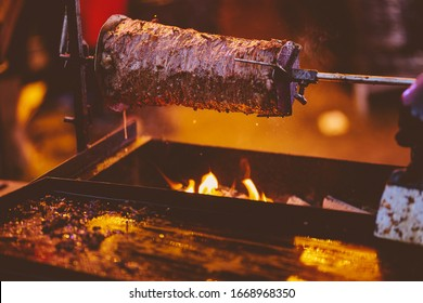 shawarma, lamb on a spit. street food. Doner Kebab on a rotating spit. A street food of Turkey. Gyros, doner grilled slowly on rotating spits. vintage photo processing
