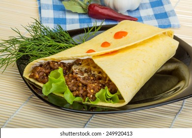 Shawarma with meat salad leaves and spices