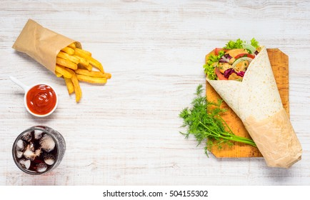 Shawarma Sandwich with Fast Food French Fries with Ice Cola and Copy Space Area