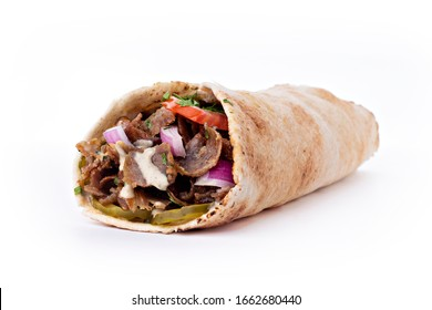 Shawarma sandwich fresh roll of, Grilled Meat and salad tortilla wrap with white sauce isolated on white background. Image