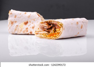 Shawarma sandwich gyro fresh roll of lavash (pita bread) chicken beef shawarma falafel RecipeTin Eatsfilled with grilled meat, mushrooms, cheese. Traditional Middle Eastern snack. On white background