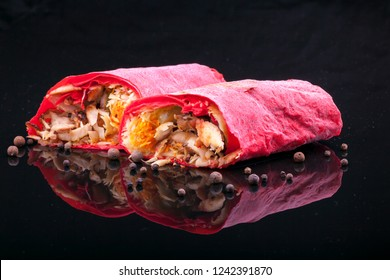 Shawarma sandwich gyro fresh roll of lavash (pita bread) chicken beef shawarma falafel RecipeTin Eatsfilled with grilled meat, mushrooms, cheese. Traditional Middle Eastern snack. On black background