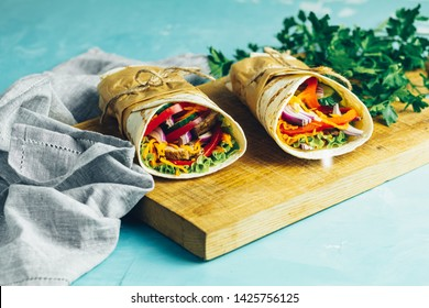 Shawarma sandwich gyro fresh roll of lavash (pita bread) chicken beef shawarma falafel RecipeTin Eats Filled with grilled meat, vegetables, cheese. Traditional Middle Eastern snack.