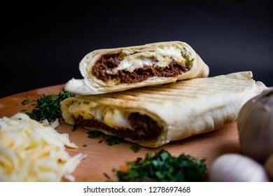 Shawarma sandwich with ingredients on dark background. Top view. sandwich in pita bread. burrito