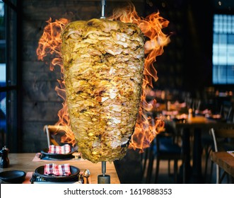Shawarma sandwich. Shawarma is a Levantine Arab meat preparation, where meat is placed on a spit and may be grilled for as long as a day. Shawarma can be served with various toppings and vegetables su