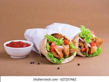 Shawarma sandwich with tomato sauce