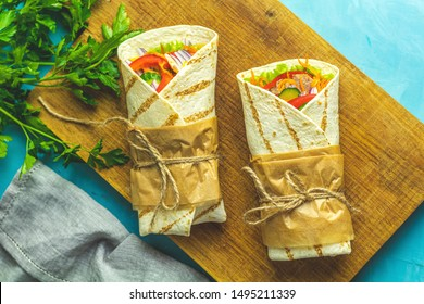 Shawarma  tacos al pastor gyro or gyros fresh roll of lavash (pita bread) chicken beef shawarma falafel RecipeTin Eats Filled with grilled meat, vegetables, cheese. Traditional Middle Eastern snack.