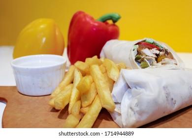 shawerma, shawarma tourtilla wrap with onion, tomato, lettuce and garilc sauce