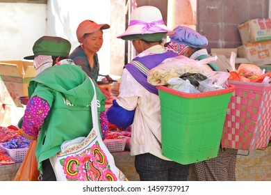 SHAXI, CHINA - MAY 17, 2019: Unidentified local people selling and buying products at Friday flea market in Shaxi village of the ancient tea horse trade route in Yunnan province, Southwestern China.