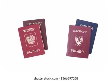 Shchelkovo,Russian Federation - Mar 09, 2019: Two foreign passport of citizen Russian Federation and Ukraine and a national passports of the Russian Federation, Ukraine on white background