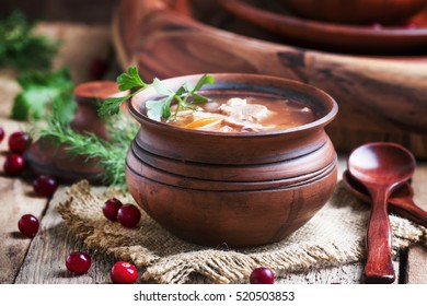 Shchi - soup made of sauerkraut, meat and tomato, old wooden background, selective focus