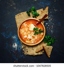 Shchi - Soup From Sauerkraut, Meat And Tomato, Black Background, Top View