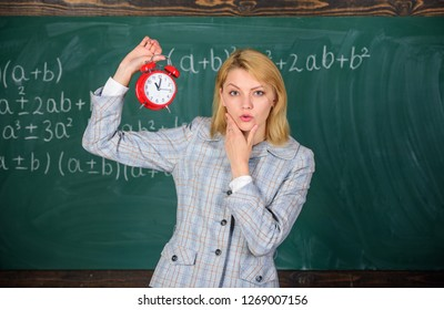 She cares about discipline. Woman teacher hold alarm clock. Girl school lecturer. What time is it. Lessons schedule. Welcome teacher school year. Health and daily regime. Educator start lesson.