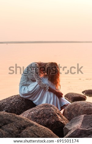 She Feels Sad Sitting Hunched On Stock Photo Edit Now 691501174