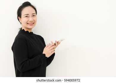 She is so happy when she is playing something to her smartphone
