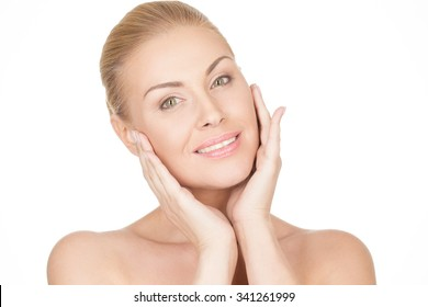She knows what her skin needs. Closeup shot of a gorgeous aging woman touching her face and smiling warmly